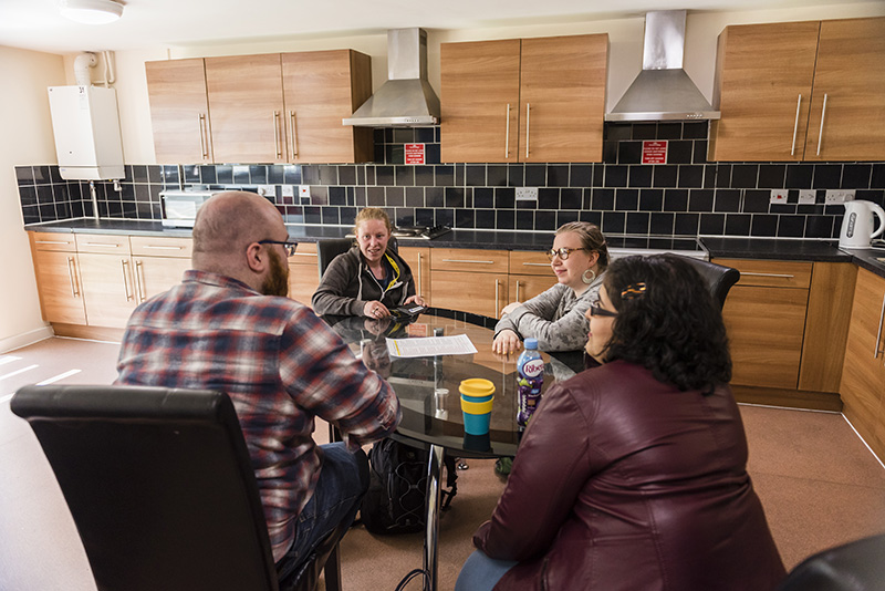 Students at a dining table in wrexham village