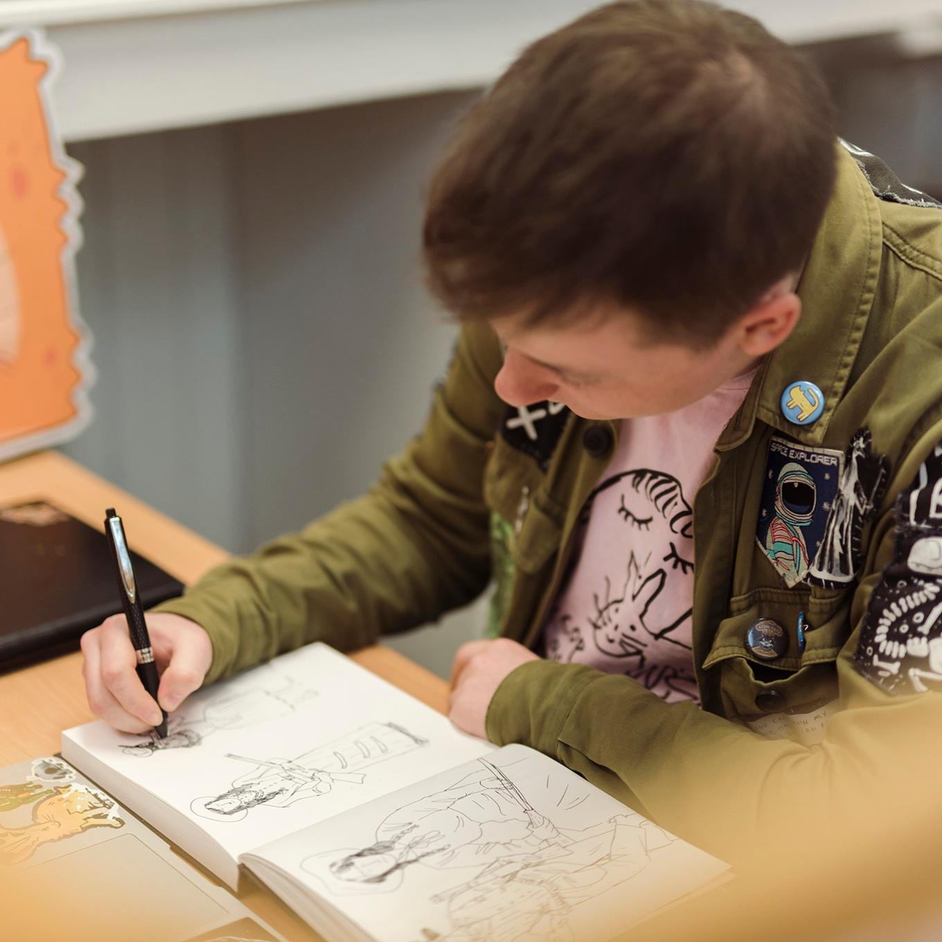 A comics student sketches out ideas