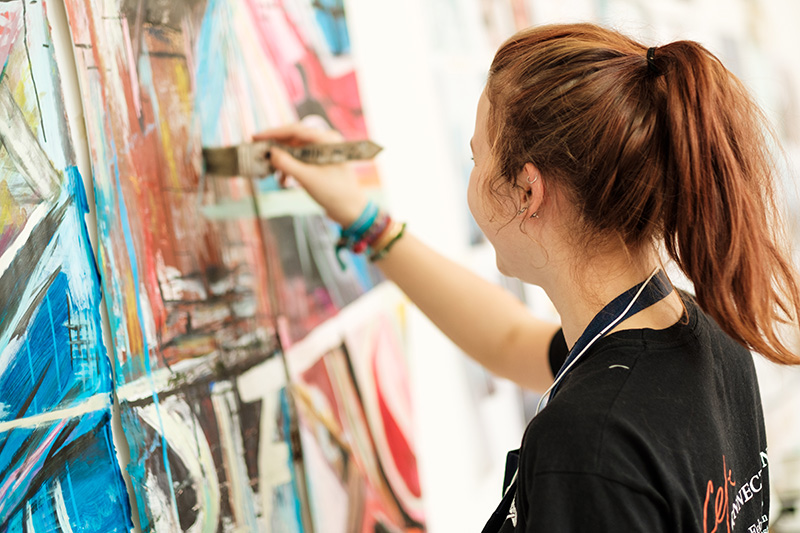 A fine art student painting