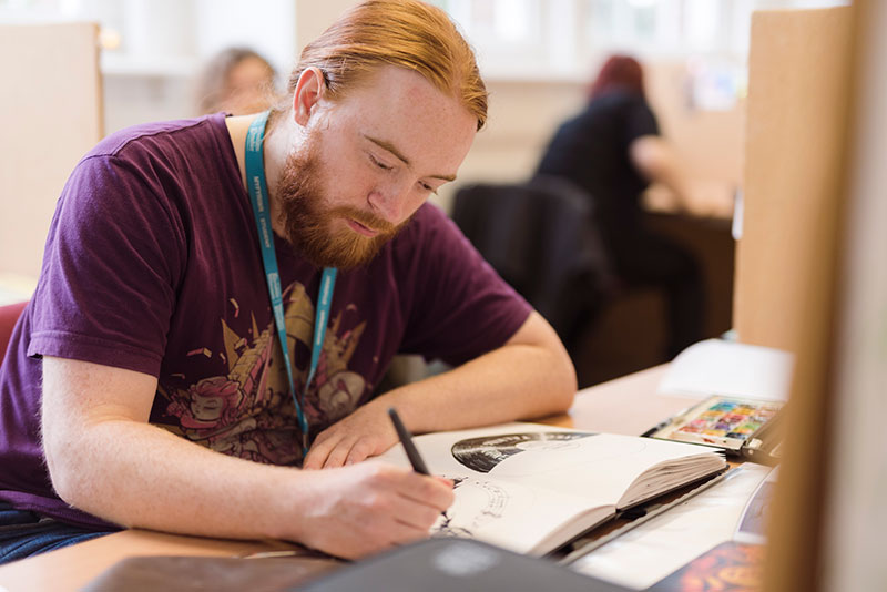 An illustration student working