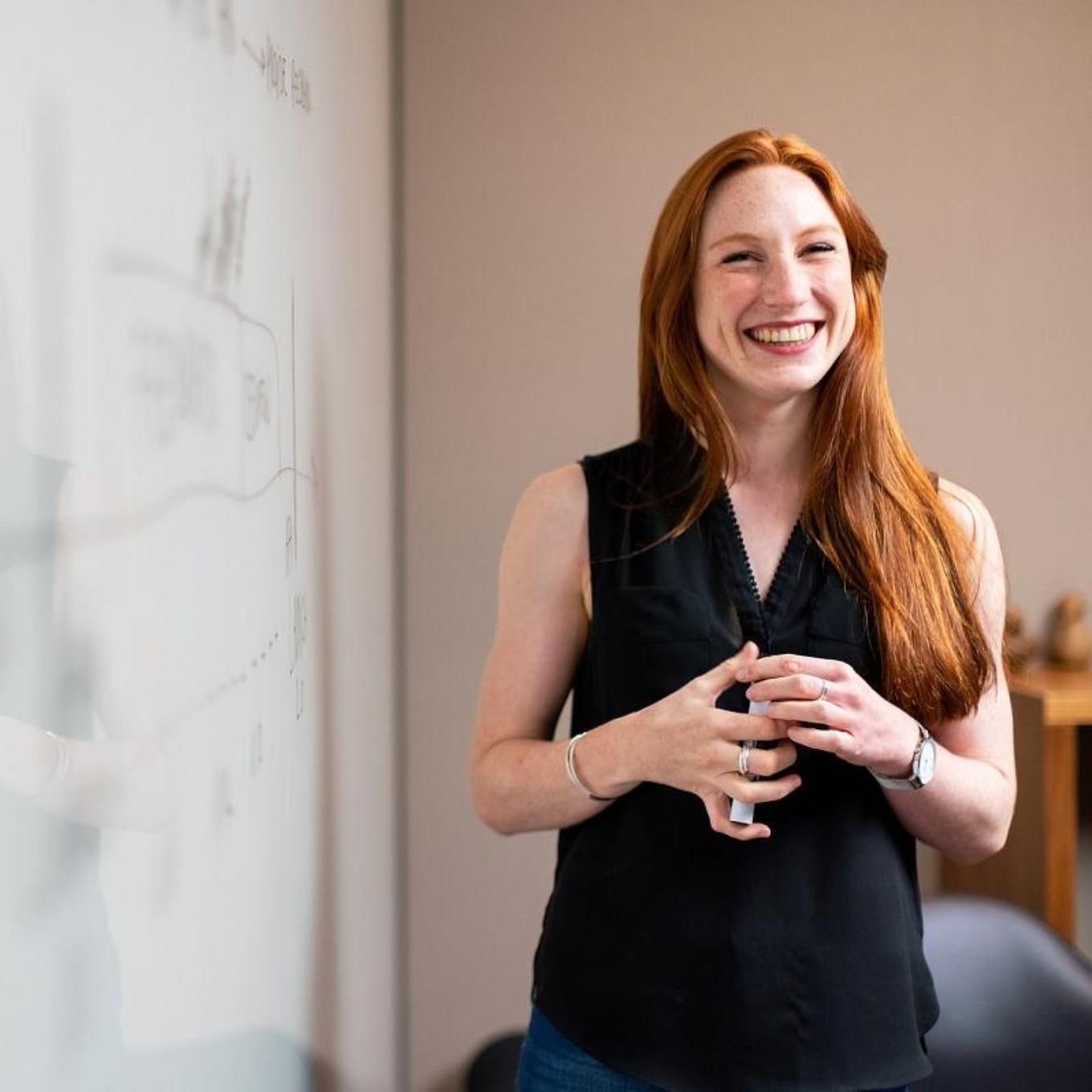 Woman standing in front of whiteboard
