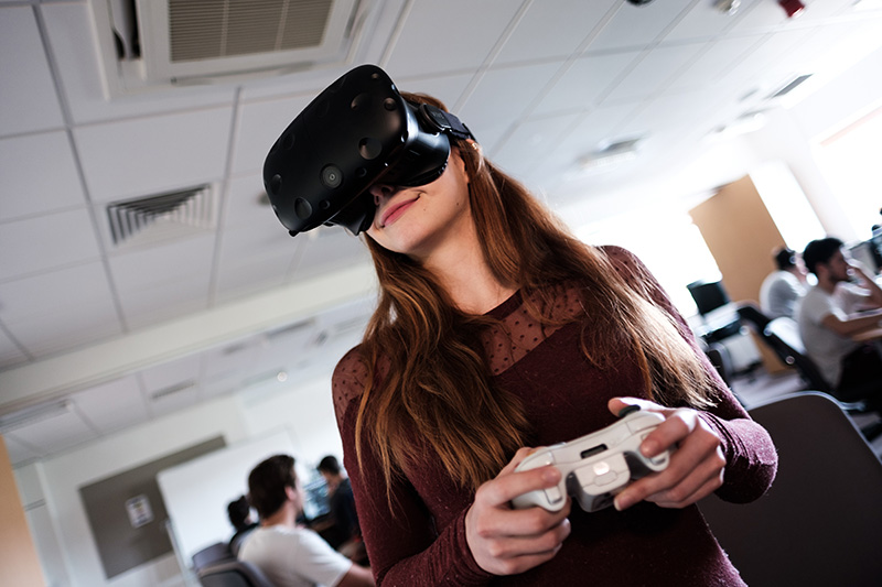 A student using a VR game