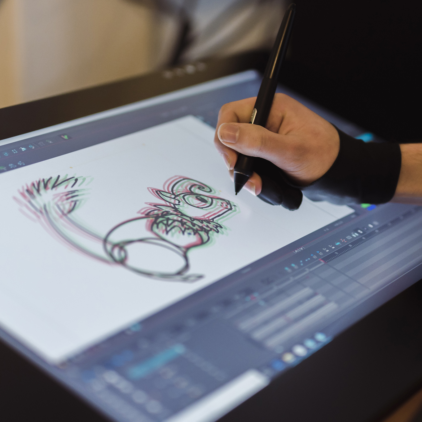 A student draws out their art concept on a tablet