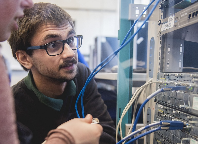 A computing student working on a project