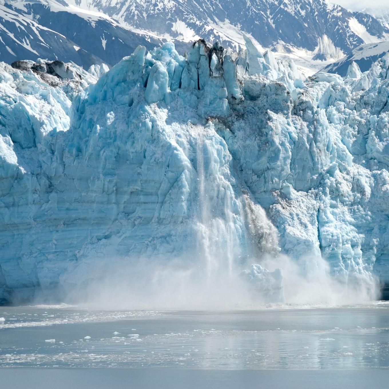 A glacier melting into the ocean