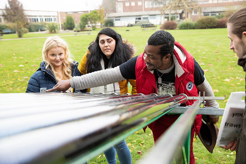 Renewable engineering students with solar panels