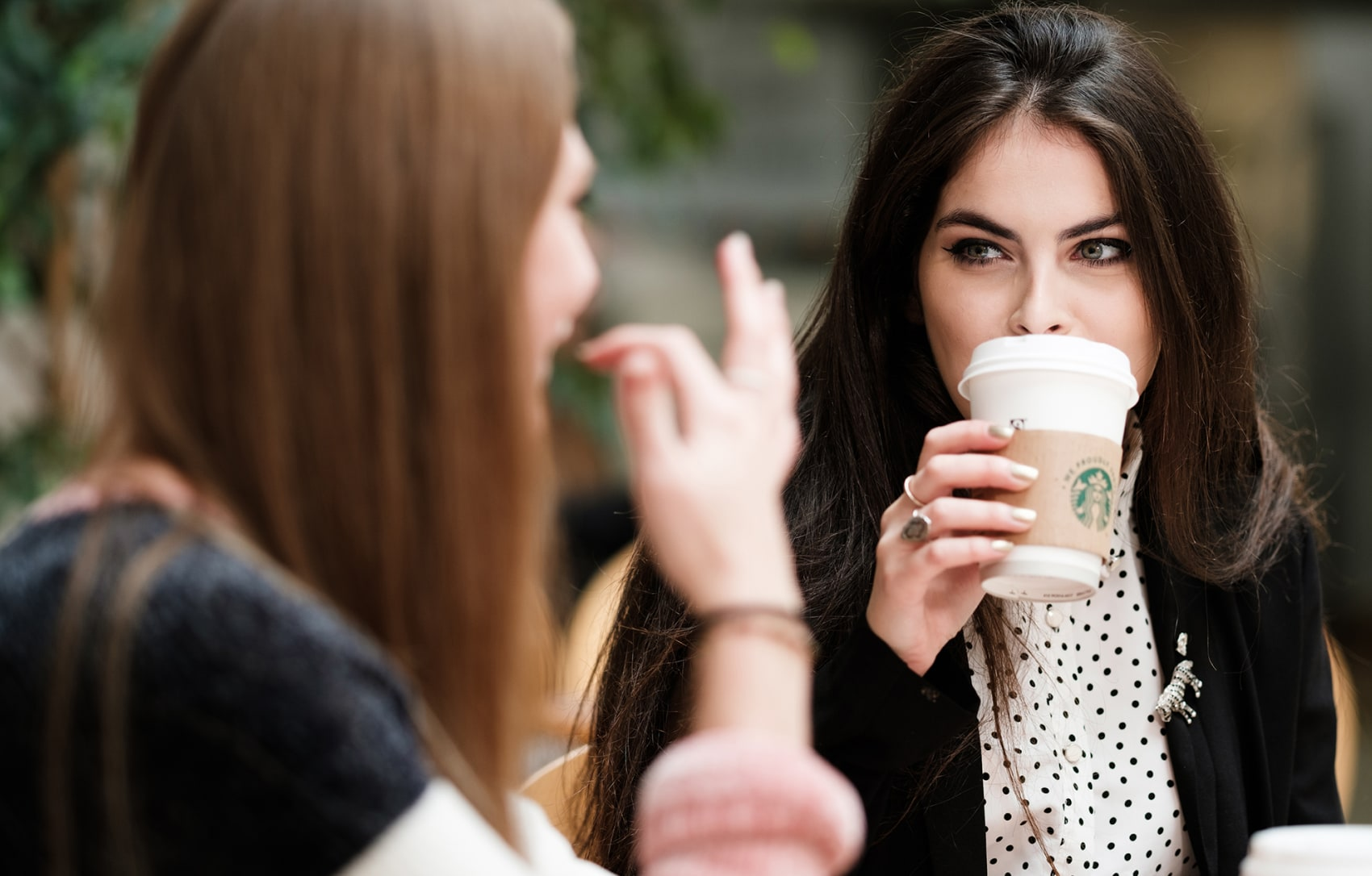 Student drinking from a Starbucks cup