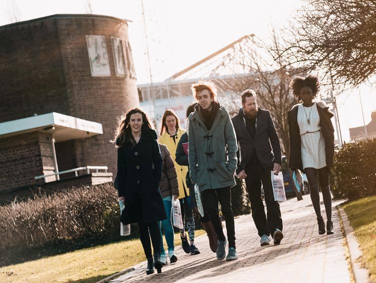 A group of students walking outside campus