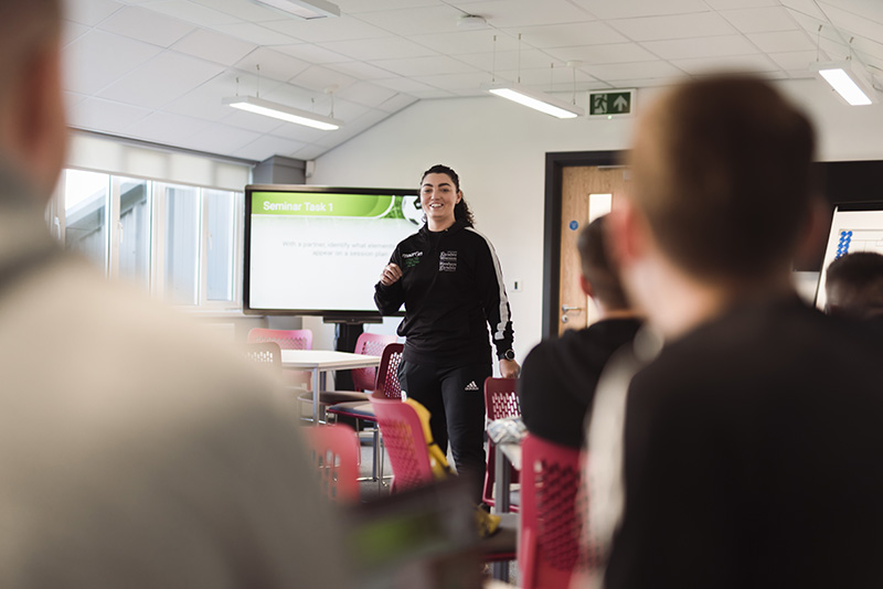 Students in a football coaching lecture